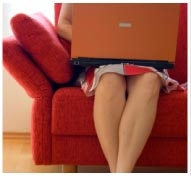 Lady with a laptop on a red couch